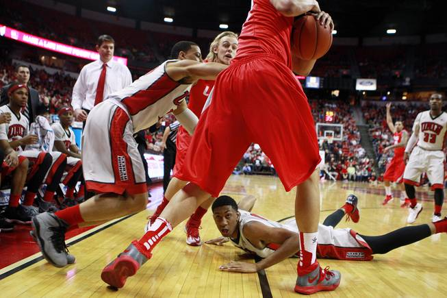UNLV forward Chris Wood hits the floor after scrambling for a loose ball with New Mexico during their Mountain West Conference game Wednesday, Feb. 19, 2014 at the Thomas & Mack Center. New Mexico won the game 68-56.