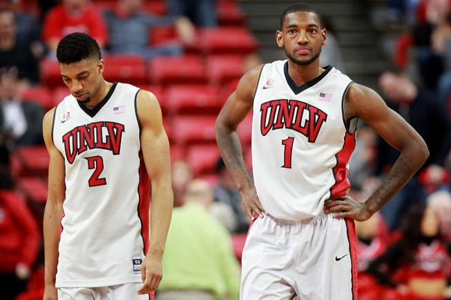 UNLV forwards Khem Birch and Roscoe Smith react during the final minutes of their game against New Mexico on Wednesday, Feb. 19, 2014, at the Thomas & Mack Center. New Mexico won 68-56.