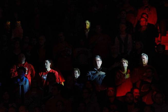 UNLV fans are lit by moving lights during the playing of the national anthem before the Rebels game against New Mexico Wednesday, Feb. 19, 2014 at the Thomas & Mack Center.