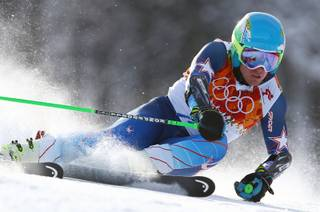 Gold medal winner Ted Ligety of the United States skis in the second run of the men's giant slalom the Sochi 2014 Winter Olympics, Wednesday, Feb. 19, 2014, in Krasnaya Polyana, Russia.