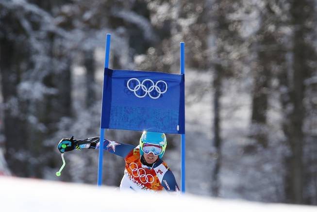 Gold medal winner Ted Ligety of the United States approaches a gate in the second run of the men's giant slalom the Sochi 2014 Winter Olympics, Wednesday, Feb. 19, 2014, in Krasnaya Polyana, Russia.
