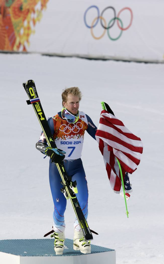 Men's giant slalom gold medalist Ted Ligety of the United States leaves the podium after a flower ceremony at the Sochi 2014 Winter Olympics, Wednesday, Feb. 19, 2014, in Krasnaya Polyana, Russia.