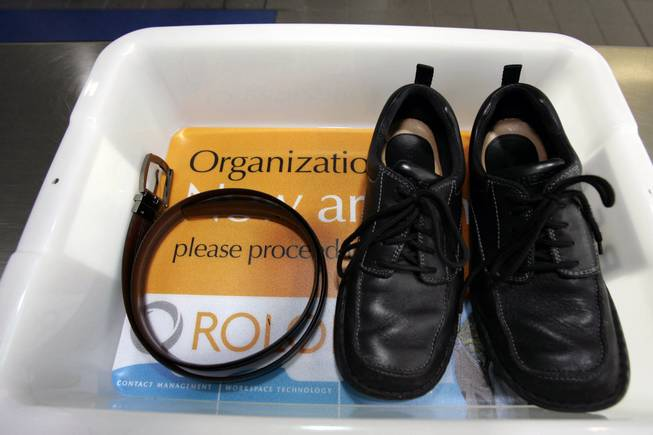 In this Wednesday, Jan. 10, 2007, file photo, a belt and shoes sit in a trays used in the safety screening of travelers done by the Transportation Security Administration, at the Los Angeles International Airport.