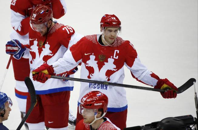 Russia defenseman Andrei Markov, left, and forward Pavel Datsyuk react after Russia lost 3-1 to Finland in a men's quarterfinal ice hockey game at the 2014 Winter Olympics, Wednesday, Feb. 19, 2014, in Sochi, Russia.
