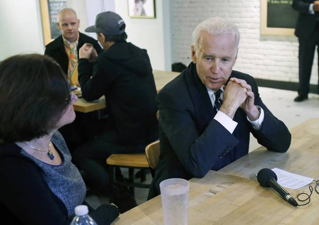 Vice President Joe Biden meets with women who have either signed up for coverage or have helped others sign up for insurance under the federal health care law during a stop at Moose and Sadie's coffee shop Wednesday, Feb. 19, 2014, in Minneapolis.