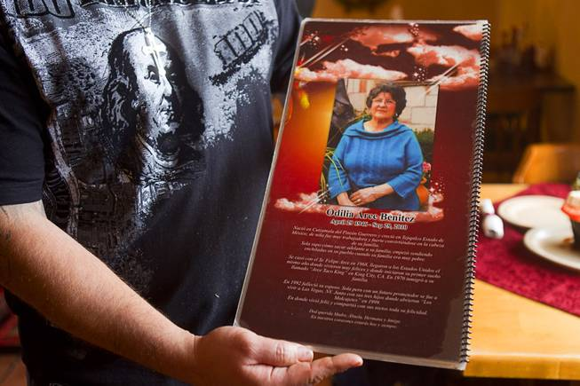 Owner David Arce holds a menu at Los Molcajetes restaurant, 1553 N. Eastern Ave., Thursday, Feb. 20, 2014.  The back of the menu is dedicated to his mother Odilia Arce Benitez who passed away in 2010. His mother and the family opened the restaurant in 1999.