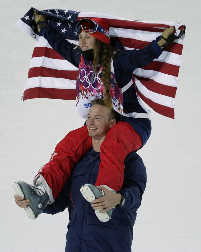 Maddie Bowman of the United States celebrates her gold medal in the women's ski halfpipe final, on the shoulders of David Wise, the men's half pipe gold medal winner, at the Rosa Khutor Extreme Park, at the 2014 Winter Olympics, Thursday, Feb. 20, 2014, in Krasnaya Polyana, Russia.
