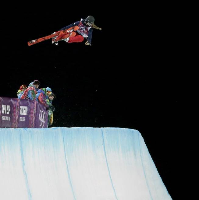 Gold medalist Maddie Bowman of the United States catches air in her first run in the finals of the women's ski halfpipe at the Rosa Khutor Extreme Park, at the 2014 Winter Olympics, Thursday, Feb. 20, 2014, in Krasnaya Polyana, Russia.