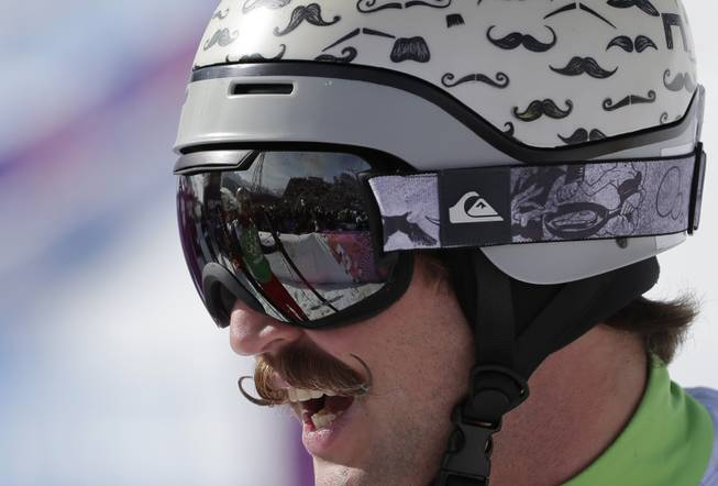 Moustaches are painted on the helmet of Slovenia's Filip Flisar during men's ski cross competition at the Rosa Khutor Extreme Park, at the 2014 Winter Olympics, Thursday, Feb. 20, 2014, in Krasnaya Polyana, Russia.
