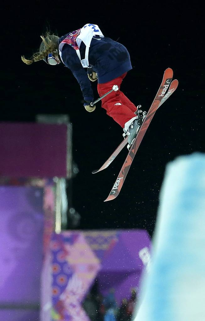 Gold medalist Maddie Bowman of the United States catches air during her second run in the women's ski halfpipe at the Rosa Khutor Extreme Park, at the 2014 Winter Olympics, Thursday, Feb. 20, 2014, in Krasnaya Polyana, Russia.