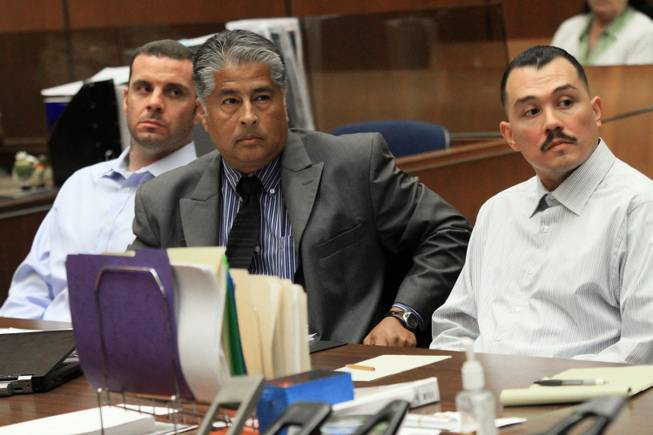 In this May 31, 2012, file photo, Marvin Norwood , left, with attorney Victor Escobedo, center, and co-defendant Louie Sanchez appear during a preliminary hearing held in Los Angeles Superior court. The two men pleaded guilty on Thursday, Feb. 20, 2014, in Los Angeles to a 2011 beating at Dodger Stadium that left San Francisco Giants fan Bryan Stow brain damaged and disabled.