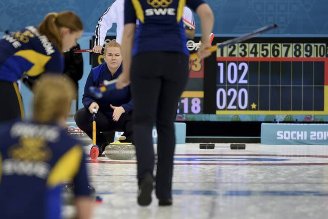 Swedish women's curler Margaretha Sigfridsson in the semifinal against the Swiss team, at the Ice Cube Curling Center in Sochi, Russia, Feb. 19, 2014. Sigfridsson and other curlers often communicate with teammates by hand signals.