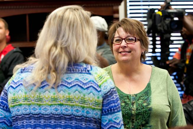 Becky Mintz, a heart recipient of another donor, visits with a friend while attending a ceremony celebrating the life of 16-year-old Aric Michael Brill, who donated six organs following his homicide five years ago, at the UMC Transplant Center Friday, February 21, 2014.