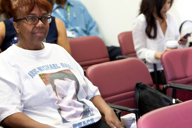 """Granny"" Candace Mbaye wears a T-shirt in memory of 16-year-old Aric Michael Brill, who donated six organs following his homicide five years ago, during a ceremony at the UMC Transplant Center Friday, February 21, 2014.  Granny used to cook Brill's favorite fried chicken for him while he frequently visited her home."