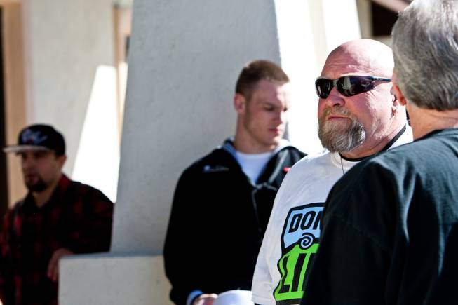 Don Brill and his son, Kevin (center) wait outside as people arrive for a ceremony celebrating the life of his younger son 16-year-old Aric Michael Brill, who donated six organs following his homicide five years ago, at the UMC Transplant Center Friday, February 21, 2014.