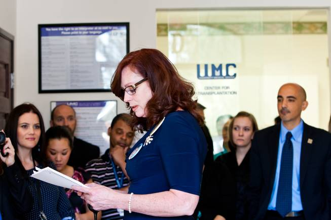Karen Brill shares memories of her 16-year-old son Aric Michael Brill, who donated six organs following his homicide five years ago, during a ceremony celebrating his life at the UMC Transplant Center Friday, February 21, 2014.