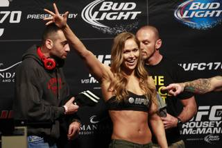 Bantamweight champion Ronda Rousey waves to fans during the weigh in for UFC 170 Friday, Feb. 21, 2014 at the Mandalay Bay Events Center in this file photo.