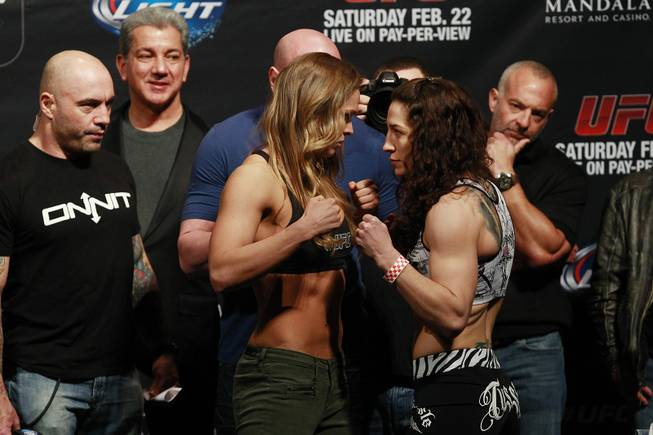 Bantamweight champion Ronda Rousey and challenger Sara McMann face off during the weigh in for UFC 170 Friday, Feb. 21, 2014 at the Mandalay Bay Events Center.
