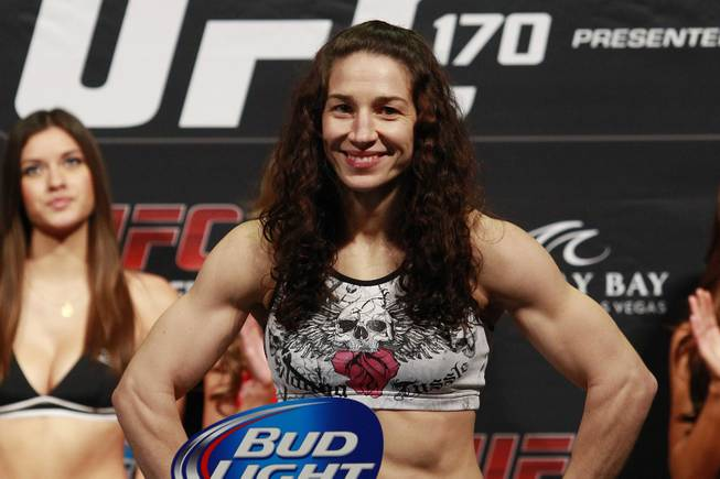 Bantamweight challenger Sara McMann smiles while making weight during the weigh in for UFC 170 Friday, Feb. 21, 2014 at the Mandalay Bay Events Center.