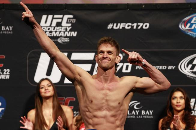 Mike Pyle poses after making weight during the weigh in for UFC 170 Friday, Feb. 21, 2014 at the Mandalay Bay Events Center.