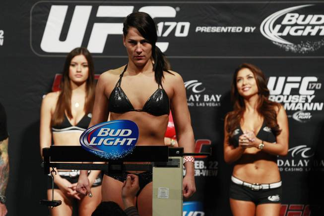 Jessica Eye stands on the scale during the weigh in for UFC 170 Friday, Feb. 21, 2014 at the Mandalay Bay Events Center.