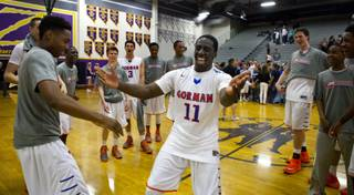 Bishop Gorman's Obim Okeke leads a celebration dance with teammates following their Sunset Regional championship game win Friday, Feb. 21, 2014.