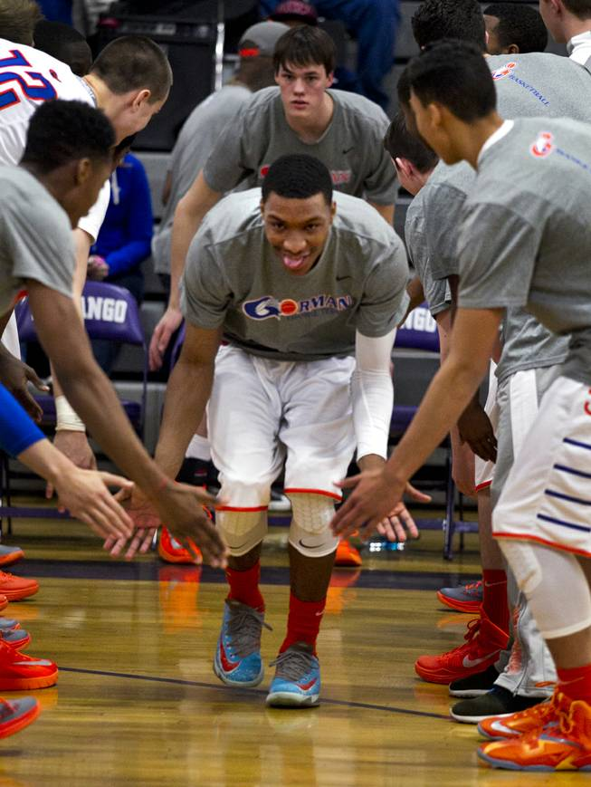 Bishop Gorman's Nick Blair is welcomed onto the court by teammates as they face Centennial in their Sunset Regional championship game Friday, Feb. 21, 2014.