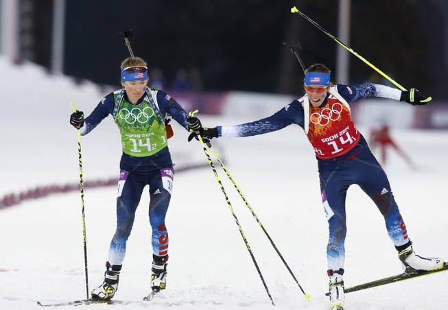 United States' Susan Dunklee, right, changes to Hannah Dreissigacker during the women's biathlon 4x6k relay, at the 2014 Winter Olympics, Friday, Feb. 21, 2014, in Krasnaya Polyana, Russia. (AP Photo/Dmitry Lovetsky)