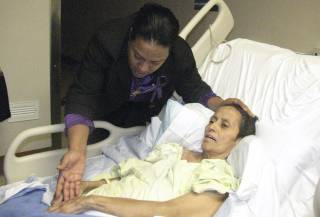 Maria Gomez in the hospital struggling with cancer after having survived a machete attack by her ex-boyfriend.