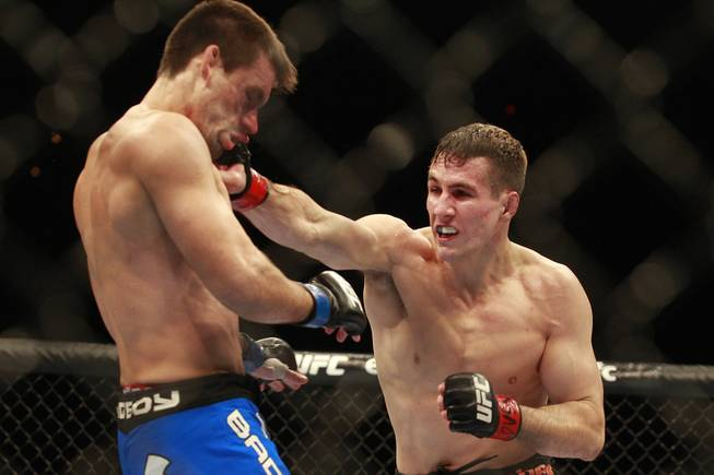 Rory MacDonald hits Demian Maia with a right during their fight at UFC 170 Saturday, Feb. 22, 2014 at the Mandalay Bay Events Center.
