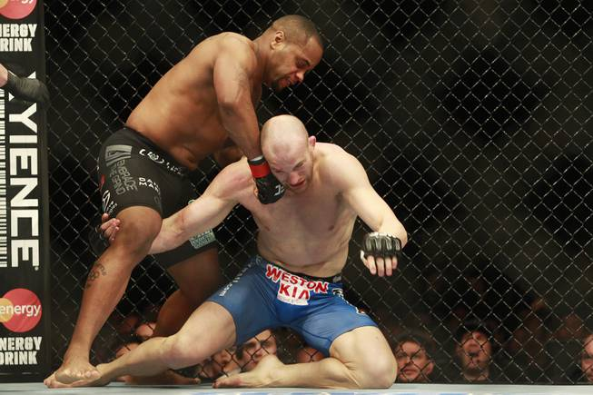 Daniel Cormier sends Patrick Cummins to the mat on his way to a first round TKO during their fight at UFC 170 Saturday, Feb. 22, 2014 at the Mandalay Bay Events Center.