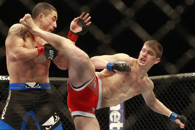 Stephen Thompson lands a kick to Robert Whittaker during their fight at UFC 170 Saturday, Feb. 22, 2014 at the Mandalay Bay Events Center.