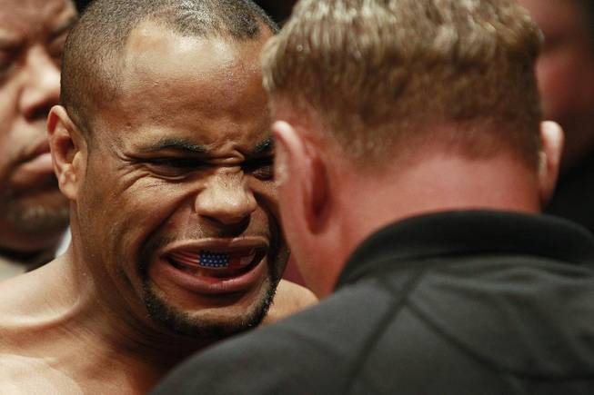 Daniel Cormier has his mouth piece checked before his fight against Patrick Cummins at UFC 170 Saturday, Feb. 22, 2014 at the Mandalay Bay Events Center. Cormier won by TKO in the first round.