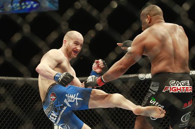 Patrick Cummins lands a kick to the leg of Daniel Cormier during their fight at UFC 170 Saturday, Feb. 22, 2014 at the Mandalay Bay Events Center. Cormier won by TKO in the first round.