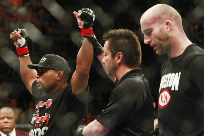 Referee Mario Yamasaki raises Daniel Cormier's arm after his defeat of Patrick Cummins at UFC 170 Saturday, Feb. 22, 2014 at the Mandalay Bay Events Center. Cormier won by TKO in the first round.