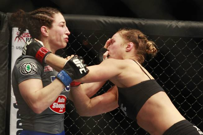 Sara McMann shoves Ronda Rousey's face during their fight at UFC 170 Saturday, Feb. 22, 2014 at the Mandalay Bay Events Center. Rousey won by TKO in the first round with a knee to the McMann's liver.