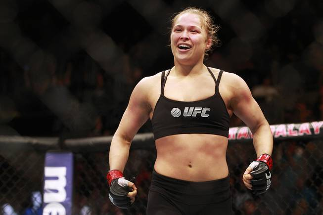 Ronda Rousey celebrates her victory over Sara McMann  at UFC 170 Saturday, Feb. 22, 2014 at the Mandalay Bay Events Center. Rousey won by TKO in the first round with a knee to the McMann's liver.