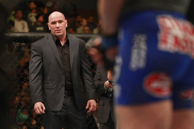 Dana White stands in the octagon after the Ronda Rousey Sara McMann fight at UFC 170 Saturday, Feb. 22, 2014 at the Mandalay Bay Events Center.