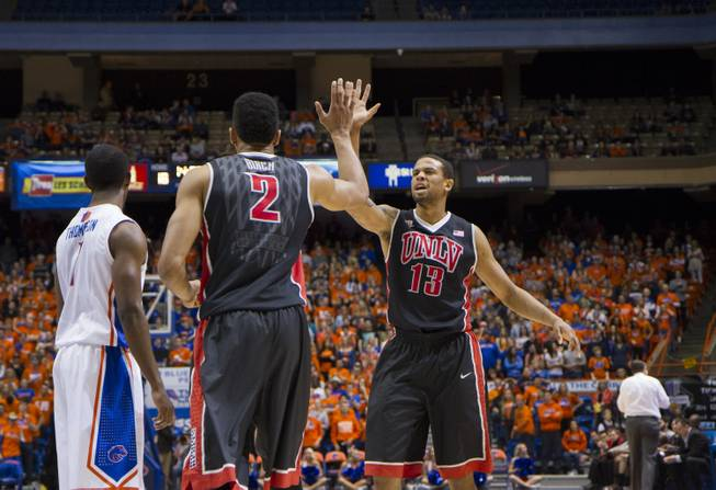 UNLV's Khem Birch and Bryce Dejean-Jones celebrate a play in the Rebels' 91-90 overtime loss to Boise State at Taco Bell Arena in Boise on Saturday, Feb. 22, 2014.
