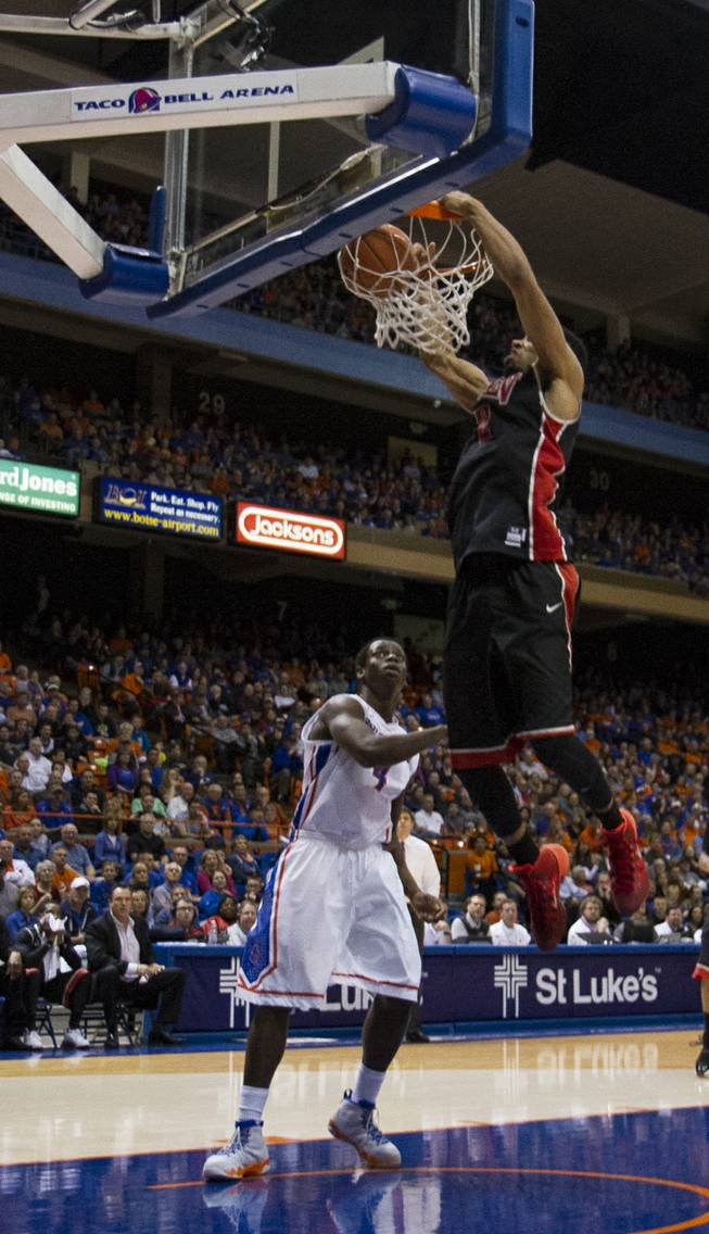 UNLV's Khem Birch dunks in the Rebels' 91-90 overtime loss to Boise State at Taco Bell Arena in Boise on Saturday, Feb. 22, 2014.