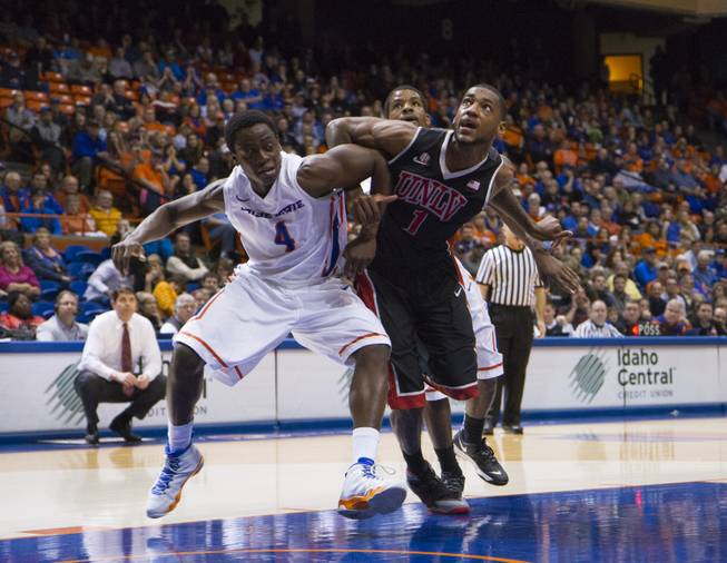 Boise State's Thomas Bropleh and UNLV's Roscoe Smith battle for position in UNLV's 91-90 overtime loss to Boise State at Taco Bell Arena in Boise on Saturday, Feb. 22, 2014.