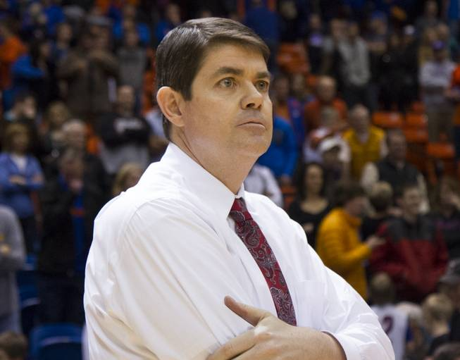 UNLV Coach Dave Rice looks on during UNLV's 91-90 overtime loss to Boise State at Taco Bell Arena in Boise on Saturday, Feb. 22, 2014.