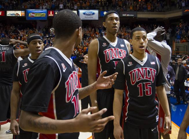 UNLV players Kevin Olekaibe, from left, Daquan Cook, Christian Wood and Kendall Smith are stunned by the ending of UNLV's 91-90 overtime loss to Boise State at Taco Bell Arena in Boise on Saturday, Feb. 22, 2014.