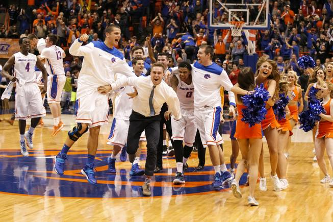 Boise State celebrates after a video review reveals the Broncos had won an NCAA college basketball game against UNLV in Boise, Idaho, on Saturday, Feb. 22, 2014. Boise State won 91-90 in overtime.