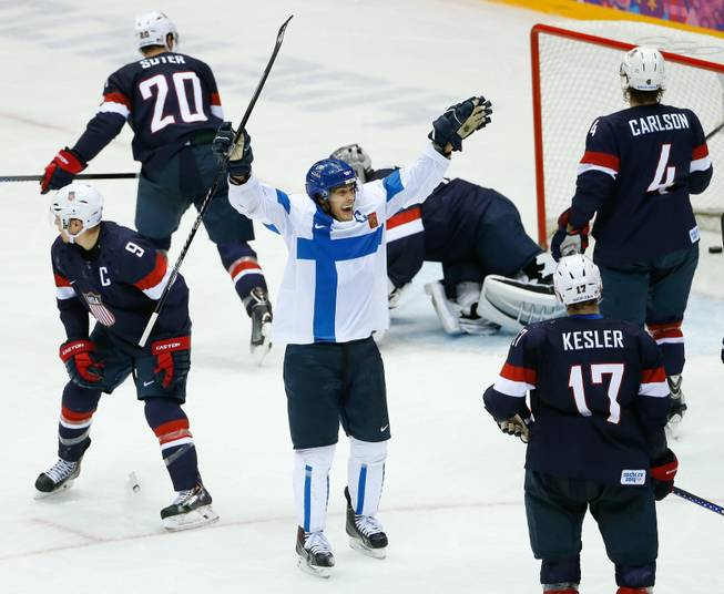 Teemu Selanne of Finland (8) celebrates his goal against Team USA during the third period of the men's bronze medal ice hockey game at the 2014 Winter Olympics, Saturday, Feb. 22, 2014, in Sochi, Russia.