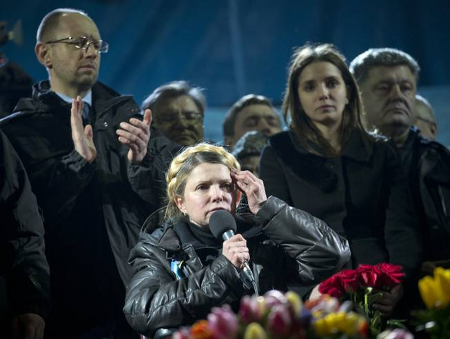 Former Ukrainian prime minister Yulia Tymoshenko, center, addresses the crowd in central Kiev, Ukraine, Saturday, Feb. 22, 2014. Hours after being released from prison, the former Ukrainian prime minister and opposition icon praised the demonstrators killed in violence this week as heroes.