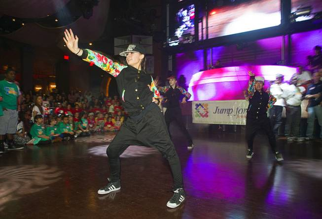 Members of the Prodigy Dance Crew perform during the second annual Dance Against Obesity Camp at the Marquee nightclub in the Cosmopolitan Las Vegas Sunday, Feb. 23, 2014. The free dance clinic was sponsored by TAO Cares and the Jump for Joy Foundation. While the children learned dance moves, parents participated in nutritional seminars.