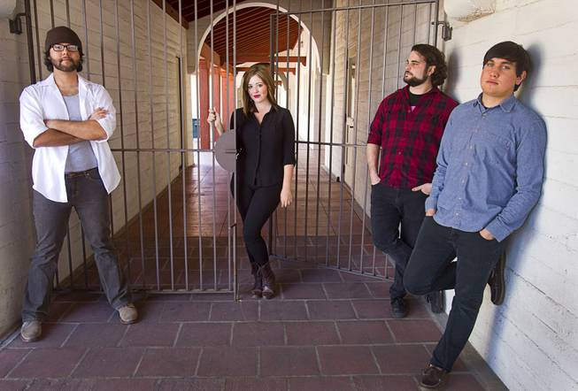 Shayna Rain and The Gents pose in downtown Las Vegas Sunday, Feb. 23, 2014. With Rain, from left, are: guitarist Steven Viveros, drummer Jeremy Tunender, and bassist Steven Zeller.