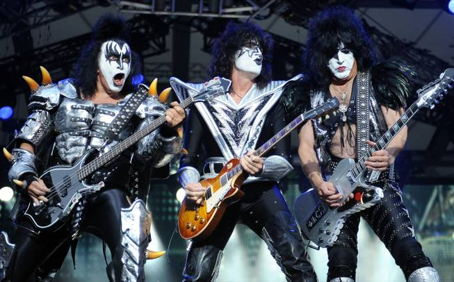In this Thursday June 13, 2013, file photo, from left: bassist Gene Simmons , guitarist Tommy Thayer and singer Paul Stanley of the US band Kiss perform on stage in Berlin, Germany. Kiss announced Sunday, Feb. 23, 2014 that the band will not perform when they are inducted into the Rock and Roll Hall of Fame in Cleveland in April. The 40-year-old band is unable to agree on which lineup should perform during the April 10 ceremony in New York City.
