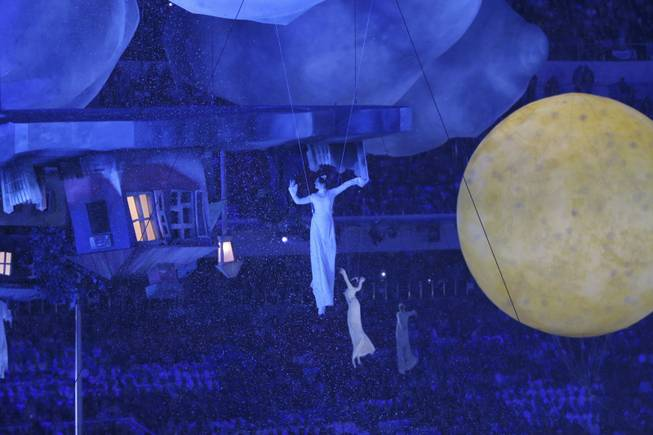 Performers create a living enactment of a painting by Marc Chagall during the closing ceremony for the 2014 Winter Olympics at Fisht Olympic Stadium in Sochi, Russia, Feb. 23, 2014. (Doug Mills/The New York Times)